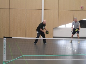 Ron Lemon, at left, is poised  to return a volley during a recent pickleball match.