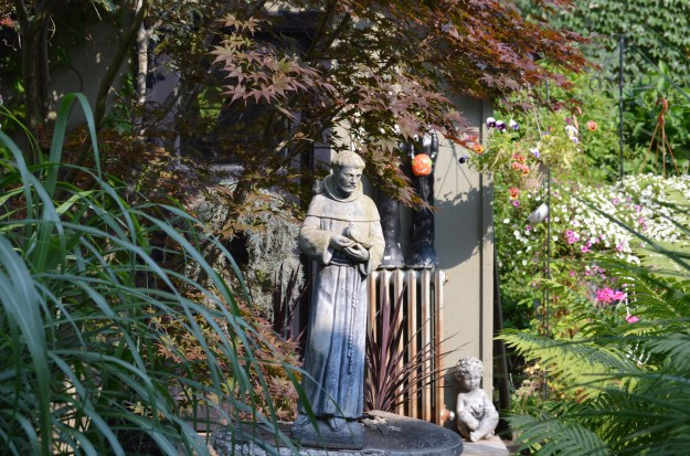 The statue of St. Francis has charm and character.