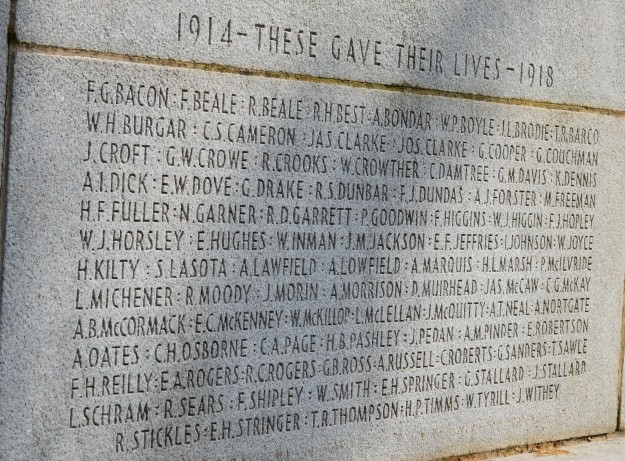 Names of local dead in World War 1 as inscribed on the Welland-Crowland  War Memorial in Welland's  Chippawa Park. The shadow on the monument is cast  by one of the flags flying nearby. (All photos by Joe Barkovich)