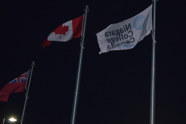 Flags at the college's Welland campus were flying high as usual early this morning. Perhaps they will be lowered to half staff today in memory of Corporal Nathan Cirillo. (Photo by Joe Barkovich)