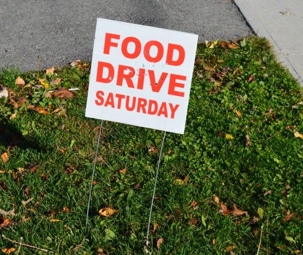 Those little signs reminding us that Saturday, Nov. 1 is Welland Food Drive day are out and about, on city streets and intersections. Remember to have your bags (or boxes!) of non-perishables at your front door Saturday by 10 a.m. so they can be picked up by volunteers. Wouldn't it be great if, one day, they could be replaced by signs that said: JOB FAIRS SATURDAY!  (Photo by Joe Barkovich)