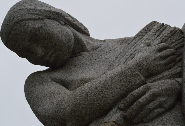 A woman is one of two figures on the Welland-Crowland War Memorial which was built to honour  war dead from the First World War. (Photo by Joe Barkovich)