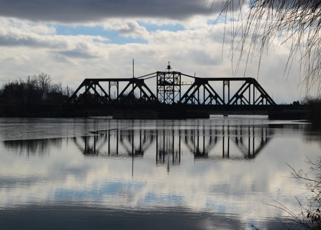 Don't be misled by the eye appeal of this scene. The old railway bridge in Welland is an eyesore and potential safety hazard. Something needs to be done with it in 2015. (Photo by Joe Barkovich)