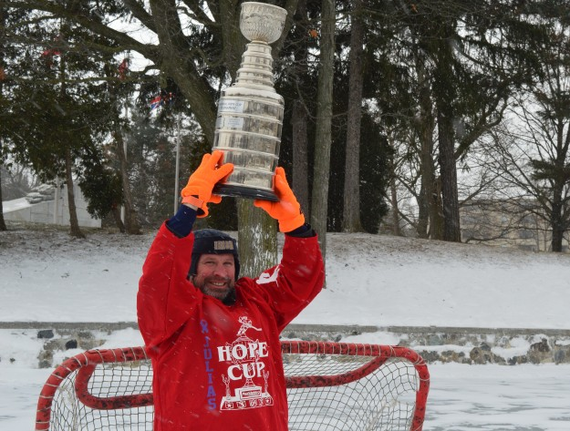 Paul Turner hoists Julia's Hope Cup Monday afternoon in Chippawa Park. The pond hockey tournament named after Paul and wife Tina's late daughter, Julia, will be played Saturday, Feb. 7. The tournament is in support of Welland's Hope Centre.  It's a celebration of and by community at its best. More to follow. (Photo by Joe Barkovich)