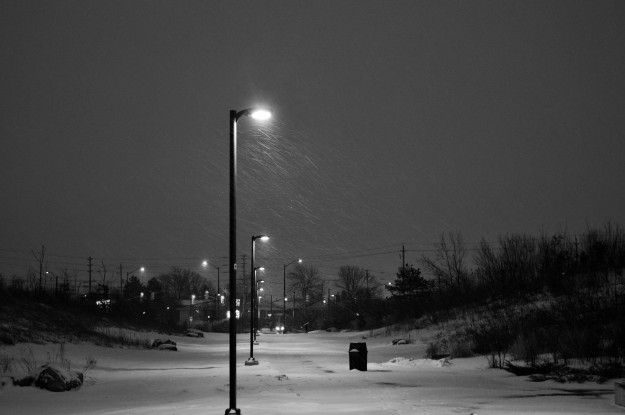A gentle snowfall, barely visible in the street light, made a morning walk a little more pretty. (Photo by Joe Barkovich)
