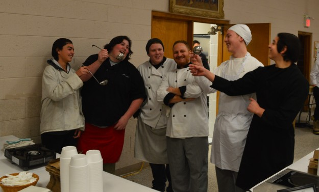 Notre Dame's soup prep team toasts the chef instructor with, what else, ladles at Friday's Soup's On! at St. Kevin's, Welland. From left: Mackenzie Fabian, Caitlin McAllister, Dustin Haslett, chef instructor Chris Begin, Aidan Harold and Nick Frattaroli. They served up stracciatella. (Photo by Joe Barkovich)