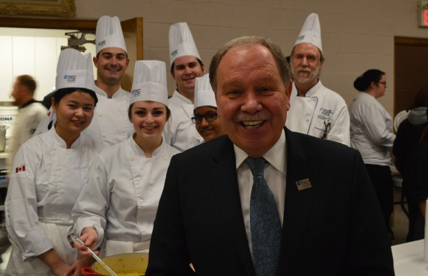 Niagara College president Dan Patterson, foreground, says the drive from his office at the Niagara-on-the-Lake campus to Welland for Soup's On! is well worth it. Pictured behind him are members of the college's Canadian Food and Wine Institute team, who served up two soups, beef with barley and roasted butternut squash. Chef professor Dave Gibson is shown at right. (Photo by Joe Barkovich)