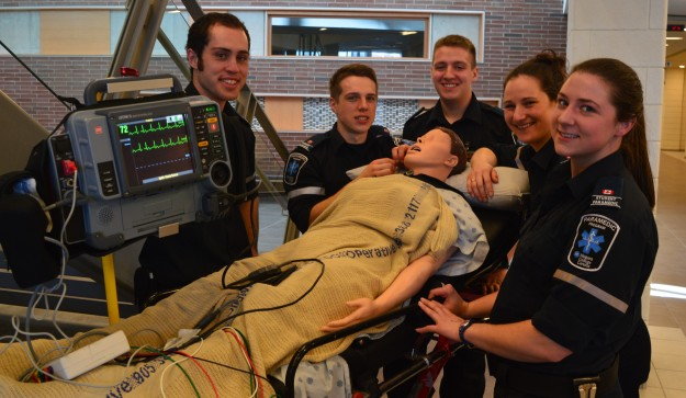 Students in the two-year paramedic program show hands-on training experiences at the open house.