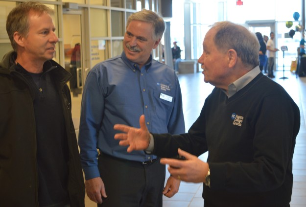 A visitor at today's Niagara College spring Open House, left, is warmly welcomed by David Veres, Community and Health Services dean, centre, and Niagara College president Dan Patterson. The open house was held at both the Welland and Niagara-on-the-Lake campuses, with free shuttle bus service between the two sites. (Photo by Joe Barkovich)