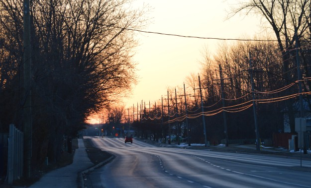 A lone vehicle heads east on Woodlawn Road near First Avenue around 7 this morning. (Photo by Joe Barkovich)