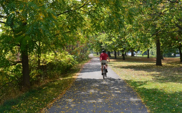 Cyclist enjoys riding a section of the canal trail in Welland. (File photo by Joe Barkovich)