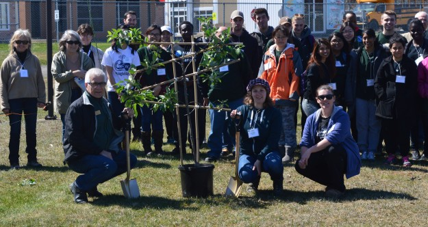 Ed Borczon from Barrie, front left, a representative of Trees Canada, took part in a ceremonial tree planting with college sustainability staff, ambassadors, and community members. Trees Canada provided funding for trees planted as part of a biodiversity project at the campus.