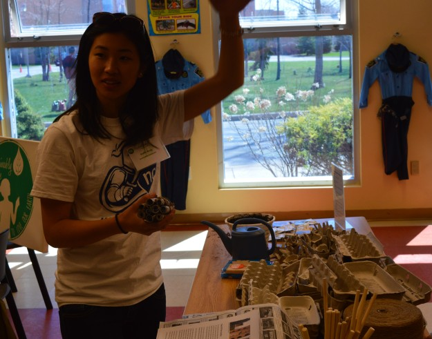 Steffie Wong, a volunteer at Niagara College's Earth Day and Arbor Day celebration on Saturday, shows part of a bee hotel, bee condo or bee house as they are variably known.  They were featured in a display for community visitors.