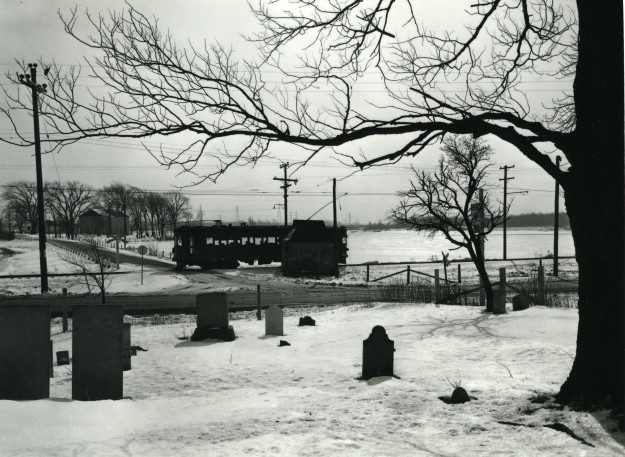 The scene across a cemetery (hey, no symbolism here) across Beaverdams Road and looking south along Marlatts Road, across part of Lake Gibson as a northbound car near mid-day stops at the  shelter called  Beaverdams to pick up a passenger. This was two weeks  before the final day, the picture ran in the Tribune just before the final day. (Supplied photo/Bob Chambers, Welland Tribune photographer, 1959)