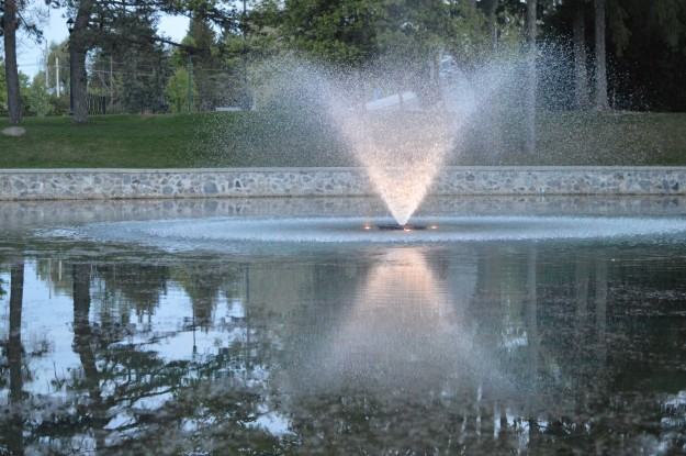 The fountain in Chippawa Park pond is alluring in this photo, early Thursday evening. The lighting is beautiful! (Photo by Joe Barkovich)