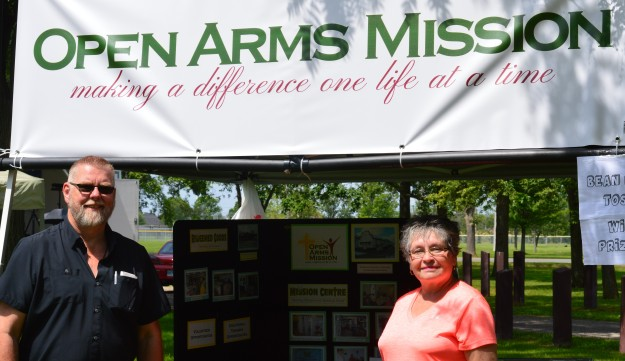 Jerry Vanderklok, CEO of Open Arms Mission and wife Murna staffed the mission's booth, which was loaded with info about its activities and programs in the community.