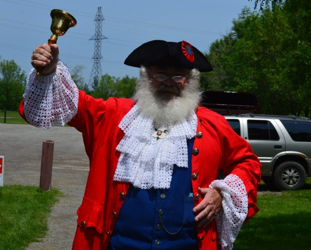 Welland's Town Crier Rob Misener announces his arrival in Memorial Park for Rose Festival's Day in the Park earlier today. Always a commanding presence, Misener is perfect for the part. Hear, hear! (Photo by Joe Barkovich)