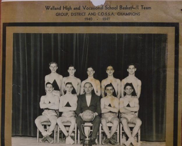 Front Row (Left to Right): Pearce Grader, Bob Cawthorn, Coach M.L. Blake, Joe Perenack, Anthony Moscato. Back Row (Left to Right): Joe Barkovich, Howard Kernahan, Dave Barnett, Dick Dickie, Ferdinand Slevar. (Healey Studios Photo)