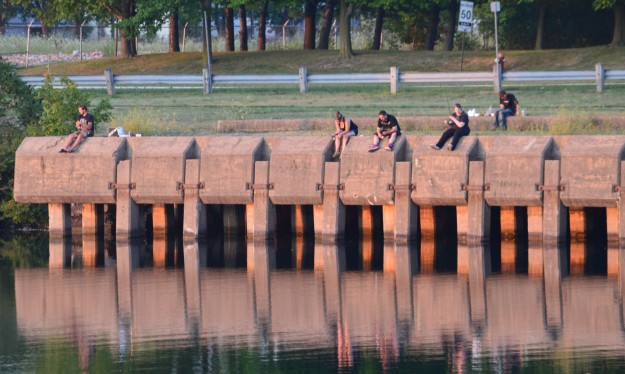 Anglers try their luck fishing from what used to be the Union Carbide dock off Canal Bank Street in Welland Monday  around sunset. (Photo by Joe Barkovich)