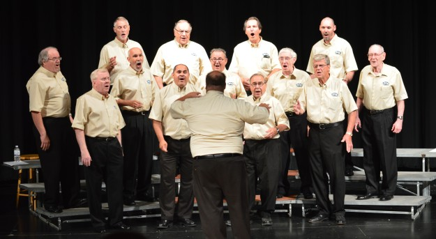 A Capella Niagara on stage at the Community Wellness Complex theatre Wednesday night. Bottom: Three Barbershop Quartets from within the choral group. (Photos by Joe Barkovich)