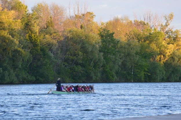 The setting sun gives an autumnal hue to this shot showing a dragonboat team training on the recreational waterway near the Pen Financial Flaterwater Community Centre Thursday evening. (Photo by Joe Barkovich. Out And About is a recurring feature on the blog.)