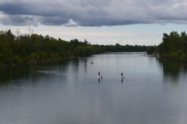 Shot this while riding across Woodlawn Bridge late this morning. Stand-up paddle boarders and kayakers were in the recreational waterway, with the Pen Financial Credit Union Flatwater Community Centre barely visible in the distance, right side. The weather was overcast and brooding, but the view is still spectacular. (Photo by Joe Barkovich)