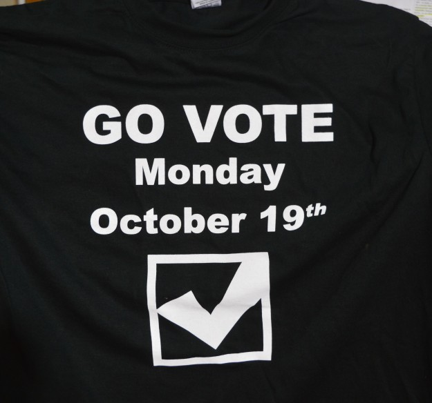 The T-shirt being worn by kNOw Poverty members in their drive to get out the vote in Niagara Centre riding. The caption on the back says: