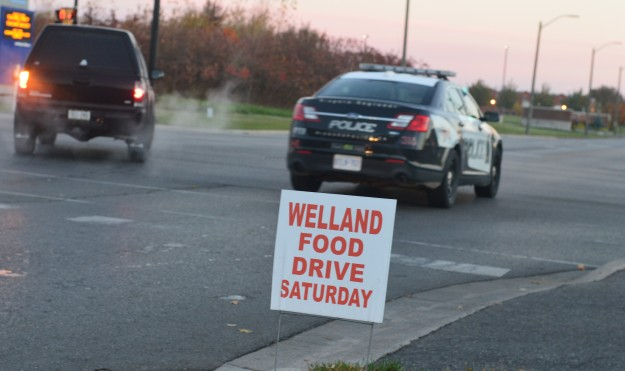 Thanks to Welland Food Drive's sign blitz, hundreds of signs like this one are to be seen posted on local intersections and streets today, effective reminders that the annual food drive takes place this Saturday. (Photos by Joe Barkovich)