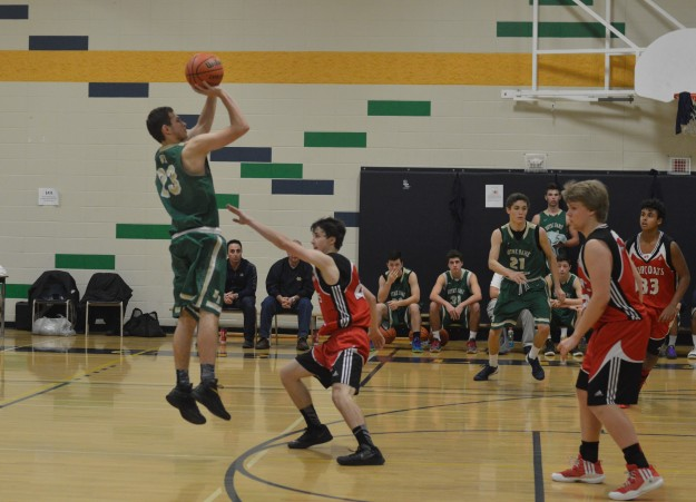 CITY SHORTS ART: Notre Dame's Mitchell Orosz goes up for a shot in ND's Tip Off tourney game against Governor Simcoe Redcoats this morning, The Irish led by quarters, 22-16, 34-32, 50-41 and 70-57 at game's end. Their next game is today at 130p.m. (Photo by Joe Barkovich)