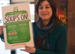 Jessica Soul, secretary of the Soup's On! committee, points to the date of the upcoming soup luncheon, January 29, 2016. (Photo by Joe Barkovich)