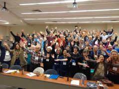 """Development and Peace delegates at a weekend regional assembly held in Welland raise their hands to """"Share the Journey"""" with sisters and brothers in the Global South, especially those who have been forced to migrate. (Photo: Natalie Rizzo)"""