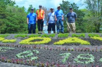 Pictured from left: Sebastien Beaudoin, Kayla Crowe, Garry Gage, Tim Sumbler, horticulture crew and Craig Danys, landscape technician.