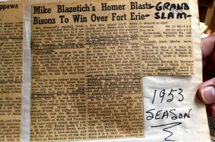 Newspaper clipping from game in which grand slam was hit.