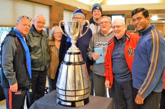Chris Van Zeyl and the Grey Cup, with friends during December 2017 visit at St. Kevin church.