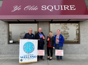 Major sponsors of the Welland Food Drive are shown in advance of the Saturday, Nov. 2 city-wide food collection. From left: Raymond Bourrassa, president of Club Richelieu; John Craig of Tim Hortons in Welland; Cheryl Lapalme, an owner of Ye Olde Squire pub; with Alain Breton of the food drive committee. Ye Olde Squire came on board for this year's drive and is providing 600 hot dogs and buns for the volunteers. Non-perishable food donations should be left outside local residences by 10 a.m. on Saturday for collection by teams of canvassers going door to door. (Supplied photo/Welland Food Drive)