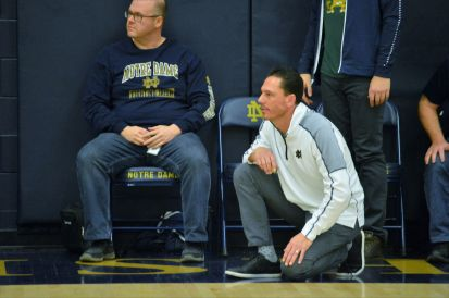 Notre Dame coach Mark Gallagher can be calm, cool and collected watching his senior Irish in hoops action, above, during Friday's Tribune Tournament game. But he can also be very animated. Great stuff, coach! (Photos by Joe Barkovich)