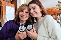 Tina and Jaclyn show a commemorative puck in this photo taken to accompany a 2019 interview.