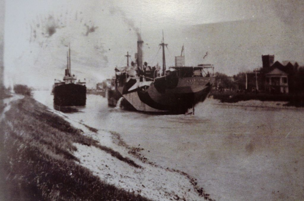 Photo two: Ocean-going ship passing a canal-size vessel. /Supplied photos.